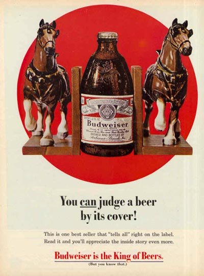 Budweiser ad - a fat Budweiser bottle between two horses / book holders - great beer ads: You can judge a beer by its cover