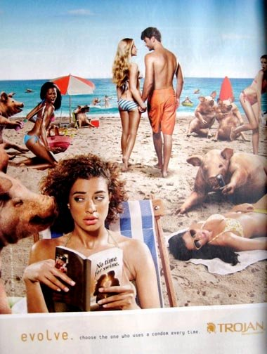 Trojan condom ads - woman surrounded with pigs on the beach