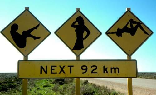 Hilarious signs and funny road sign: Really funny picture of three strippers. Strippers after 92 km