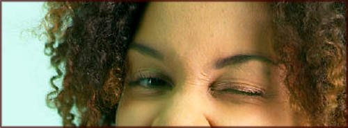 Woman winking - close up of eyes.