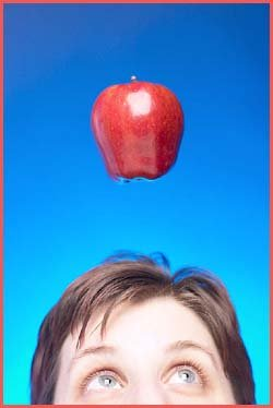 Limits are not real: Apple flying above man's head.