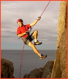 Inspirational quotes about experiences: Man climbing steep rock.