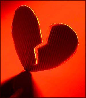 Inspiring stories on love: Picture of a broken heart. Torn down the middle.