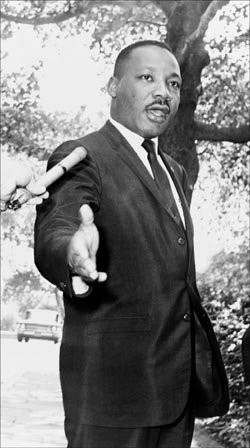 Martin Luther King Quotes: Standing up at a press conference.