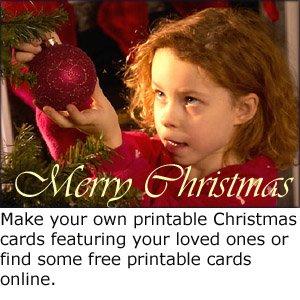 Homemade photo Christmas greeting card: Make your own printable christmas cards: Little girl hanging up Christmas decorations on Christmas tree.