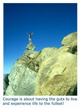 Picture of man on top of mountain rocks - message about courage and living life to the fullest
