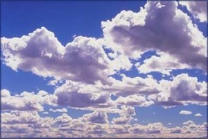 White clouds on a clear blue sky.