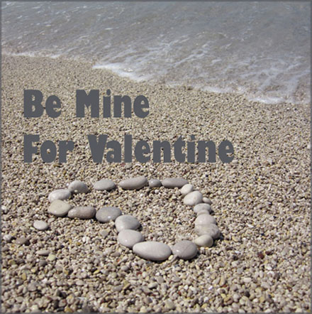 Free Valentines Day Pictures. Sharp photo of pebbles forming a heart on the sand on the beach.