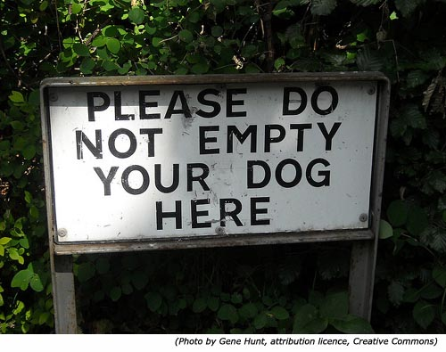 Funny stupid dog signs: Please do not empty your dog here!