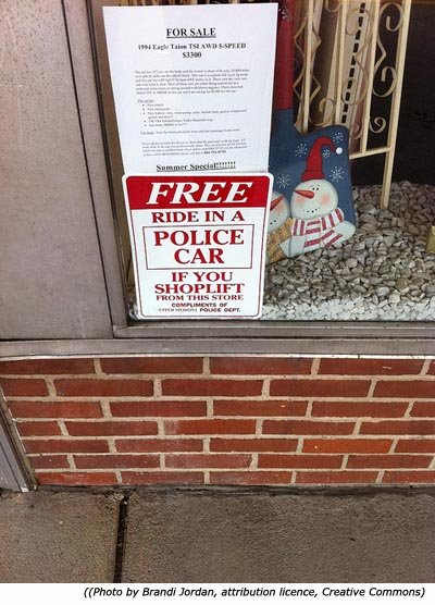 Funny police signs: Free ride in a police car if you shoplift from this store!