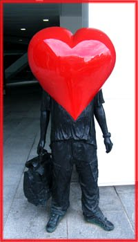 Funny Valentine Poems: Man in black with big red plastic heart as a head.