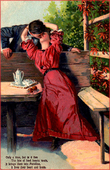 Free Valentines Day cards: Woman in red dress sitting on a bench having a cup of tea while kissing a man.