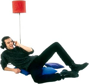 Great Valentines Gifts for him: Man lying down with headphones relaxing.