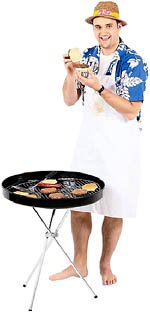 Man in apron cooking with a grill.