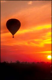 A Valentine trip in a hot air balloon in the orange sunset.