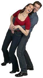 Happy couple having fun. Man holding woman.